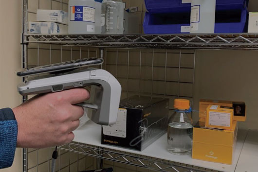 RFID Handheld Reader tracking inventory in a stockroom